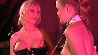 Mature mistress and her young slave in BDSM action