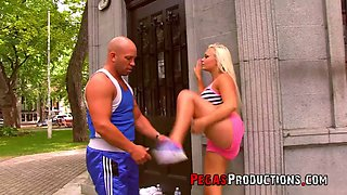 Tanned fitness chick Jessie Storm gives a titjob and gets her boobs jizzed