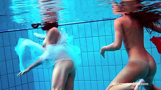 Two hotties naked in the pool