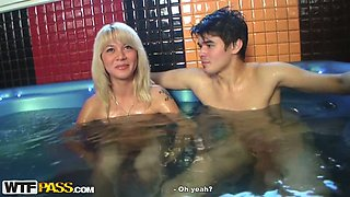 Extra naughty blonde sucks two hard cocks in the sauna
