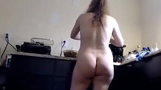 Hairy mature whit long pussy lips nude in the kitchen