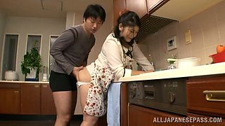 Chubby Japanese housewife gets pounded in a kitchen