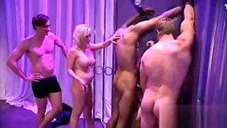 Group of men and sexy women having fun inside Playboy