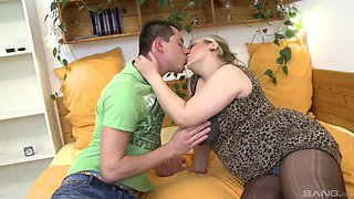 Chubby blonde with large boobs enjoys every entrance of the stiff cock