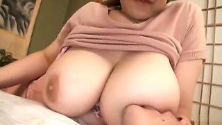 Japanese Mom Breastfeeding.