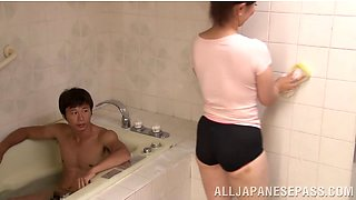 Young stud gets his cock sucked in the bathroom by a mature Asian babe