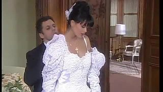 Brunette Bride Consummating the Marriage Right after the Wedding