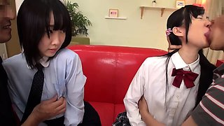 Cute Japanese schoolgirls get pounded together by older guys