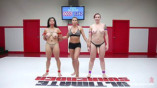 Strong FBB Mistress Kara puts on strapon and fucks pussy right in the ring