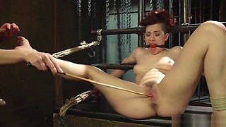 Bound lesbian is spanked and fucked