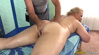 Old masseur rubs mature slut summer with fingers and toys