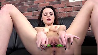 Attractive chick is peeing and masturbating shaven snatch