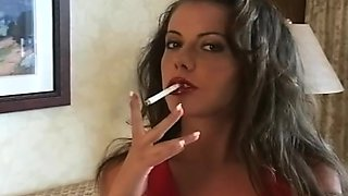 Alluring brunette is smoking cigarette in a sexy way