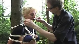 Tied to tree and ball gagged