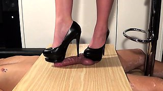 Amateur dominatrix in high heels punishes a thick cock