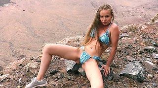 Ukrainian nympho Angel B climbs the rock specially to masturbate her twat
