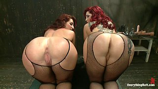 Two redheads dominated by a brunette in butt bondage scene