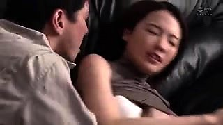 Lovely Japanese wife enjoys an intense fucking on the couch