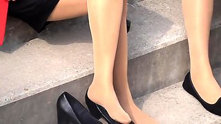 Elegant girls in nylons reveal their lovely feet outside