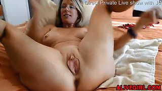 Classy mom with sexy glasses fucks her holes with huge dildos
