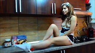 Sensual maid in uniform masturbates on the kitchen counter