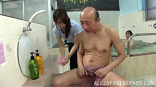 Slim Asian babe with big beautiful tits sucking an old man's cock