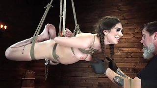 Clamped pussy slave in hogtie suspension
