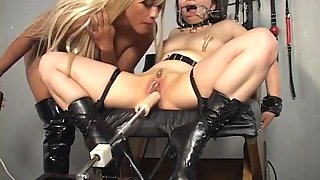 Beautiful blonde bitch dominates the slut with a fuck machine