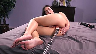 Sexy babe fucks machine and fingers ass