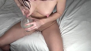 Milking my breasts into a glass for my pussy lube. Close up hand expression