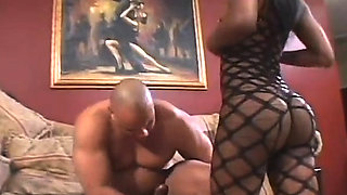 Chubby ebony babe in lingerie gives a blowjob on her knees