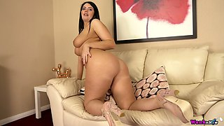 Long haired brunette Kylie K undresses to pet her own meaty shaved pussy