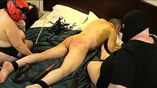 Kinky mature guy enjoying a hard spanking on the bed