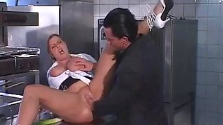 Milf with big boobs fucked in hotel kitchen