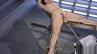 Restrained young babe drilled by sex machine