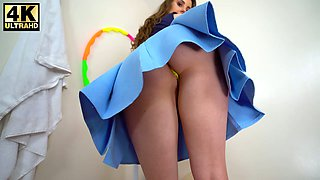 Long haired gal exposes her booty under her blue skirt just for you