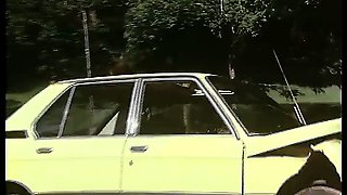 Retro girl gets fucked on top of a driving car