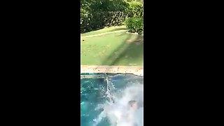 Padma Lakshmi in a bikini, jumping into a pool