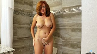 Ardent ginger Andi James is ready to play with her MILFie pussy a bit