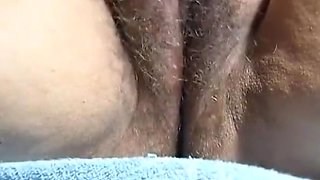 Amateur fingering wet hairy pussy rubbing clit squirting