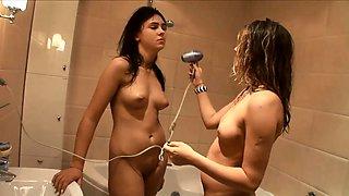 Playful European girls engage in lesbian fun in the bathroom