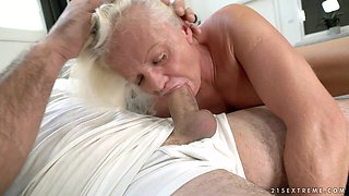 Blonde granny Anett rides a stiff cock while her big tits bounce