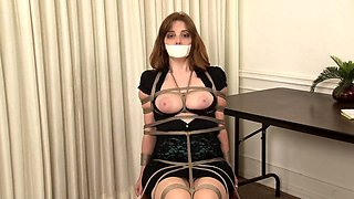 Elegant brunette milf with perfect big boobs gets restrained
