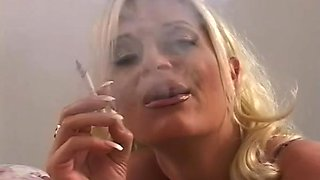 Hot blonde is smoking a and sucking that wiener