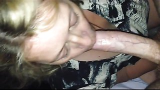 Blonde mature babe chews on a big dick