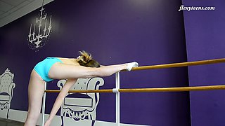 Zealous flexible hottie Julia Fiatal flashes tits and nice bum as she does stretching